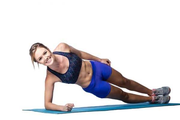 plank kobieta na macie trening klub fitness pabianice