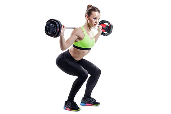 przysiady ze sztangą, ćwiczenia dla kobiet, zajęcia pump, klub fitness, pabianice, strefa ruchu