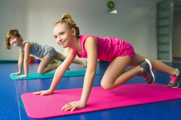 Girls doing gymnastic exercises or exercising in fitness class. ** Note: Soft Focus at 100%, best at smaller sizes